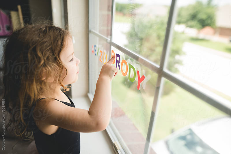 Alphabet work in home school  by Courtney Rust for Stocksy United