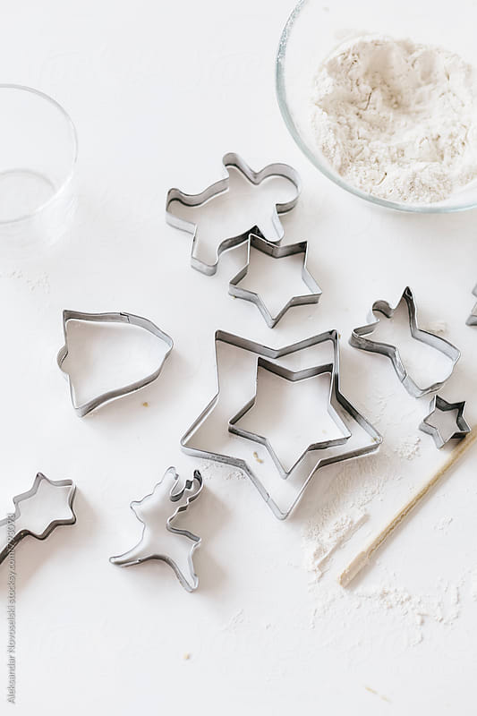 Cutters for christmas cookies and flour shot from above by Aleksandar Novoselski for Stocksy United