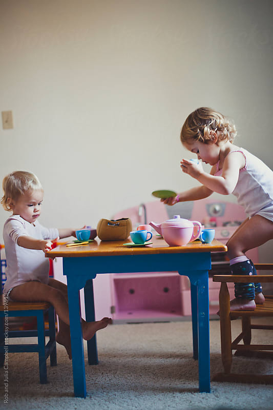 Cute toddler girls having a tea party by Rob and Julia Campbell for Stocksy United