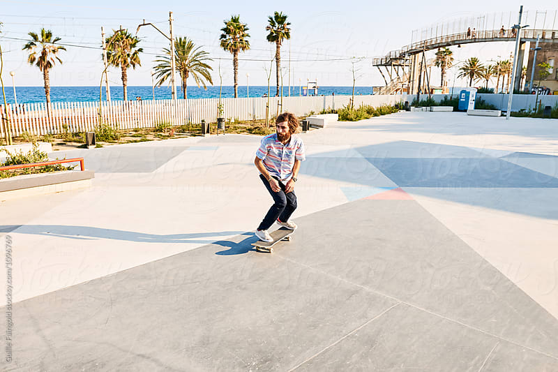 Tricker riding skateboard in skate park by Guille Faingold for Stocksy United