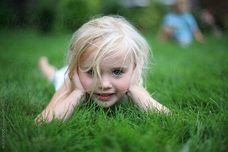 Girl In the Grass by ALICIA BOCK for Stocksy United