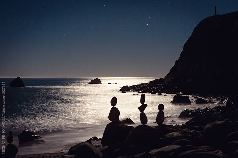 Moonlit Beach with Stars and Rock Sculpture Silhouettes by MEGHAN PINSONNEAULT for Stocksy United