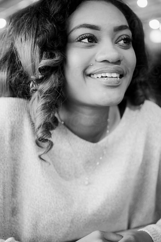 A black and white portrait of a young african american woman by Chelsea Victoria for Stocksy United
