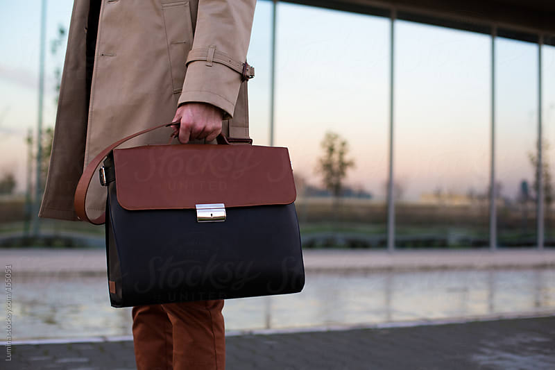 Businessman Holding His Bag by Lumina for Stocksy United