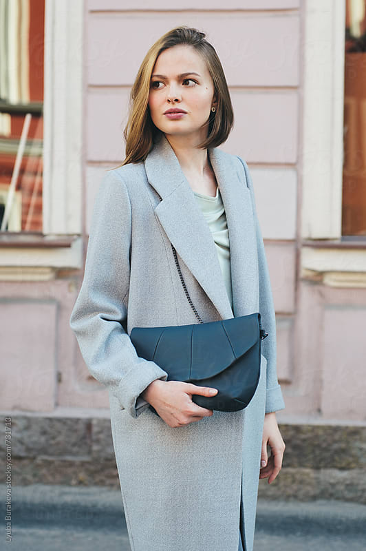 Young woman posing on the street by Lyuba Burakova for Stocksy United