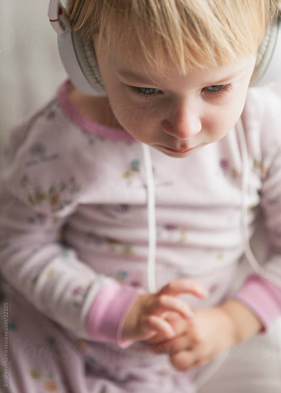 Little Girl Wearing Headphones by Stephen Morris for Stocksy United