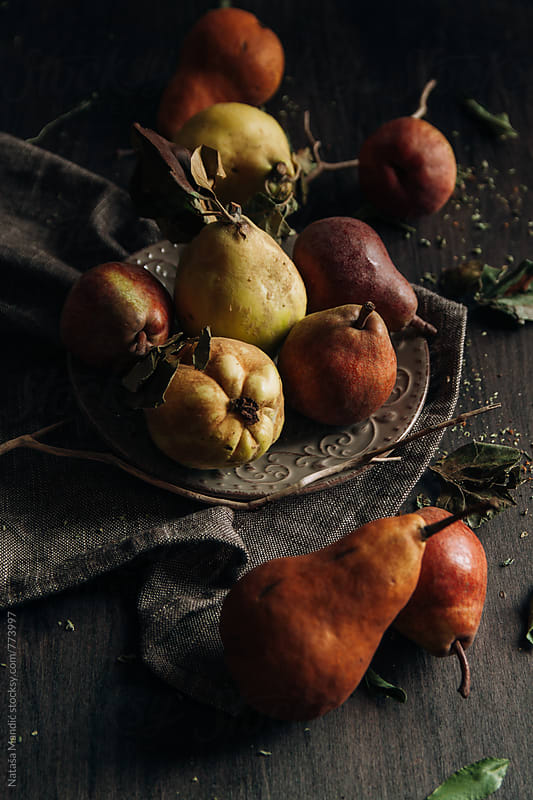 Pears on a wooden table by Nataša Mandić for Stocksy United