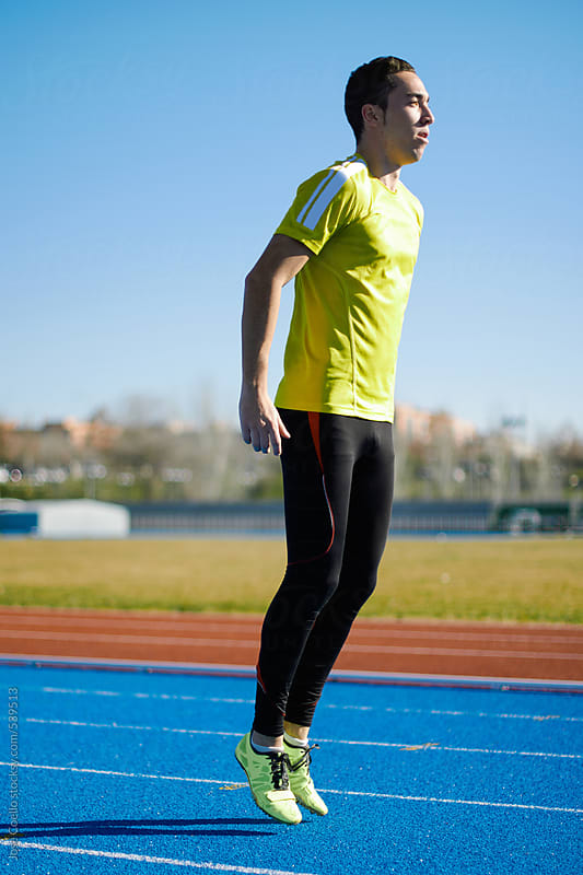 Athlete warming up. by Jose Coello for Stocksy United