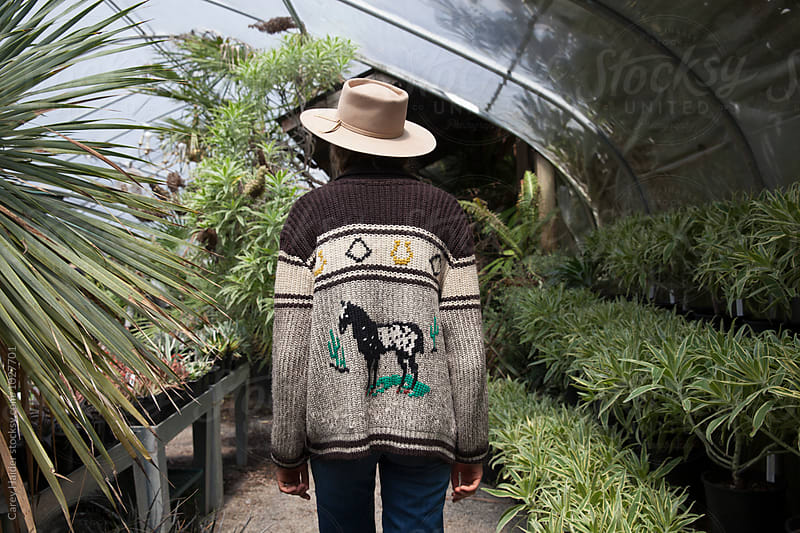 Vintage Sweater Backside In A Greenhouse On A Lady by Carey Haider for Stocksy United
