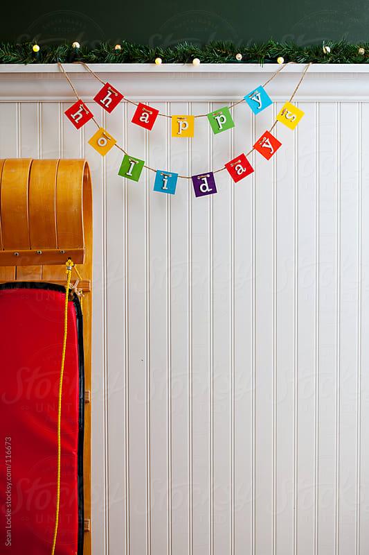 Holidays: Toboggan and Happy Holidays Sign by Sean Locke for Stocksy United
