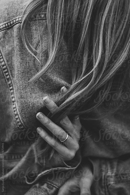 Girl holding hair from behind, hair is slipping trough her fingers by Sanja (Lydia) Kulusic for Stocksy United