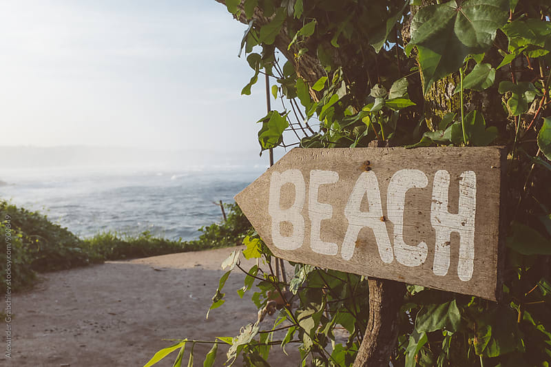 Sign Direction To The Beach by Alexander Grabchilev for Stocksy United