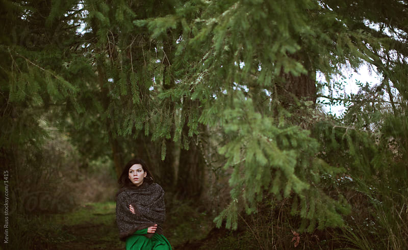 Cold Woman Under Trees by Kevin Russ for Stocksy United