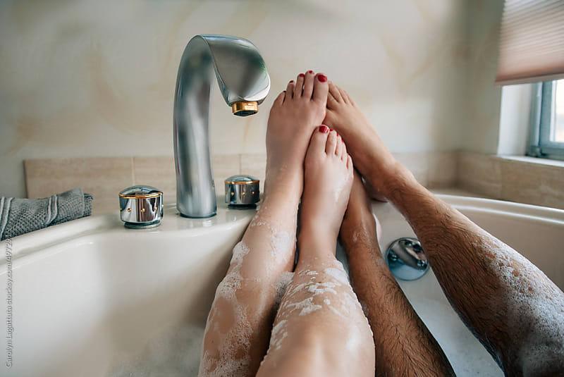 Couple in a bubble bath together by Carolyn Lagattuta for Stocksy United