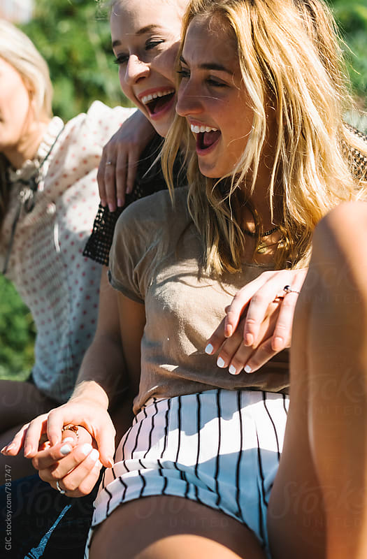 Friends having fun outdoors by Simone Becchetti for Stocksy United