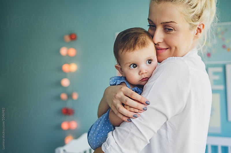 Beautiful Woman Huging a Baby  by Lumina for Stocksy United