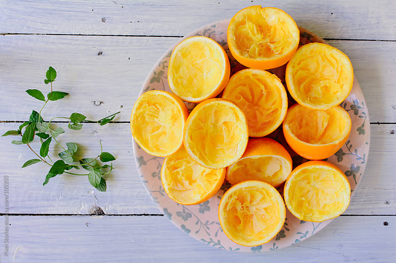 Squeezed oranges by Pixel Stories for Stocksy United
