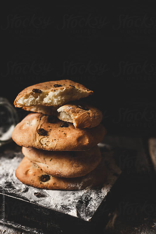 Olive and rosemary bread by Natasa Kukic for Stocksy United