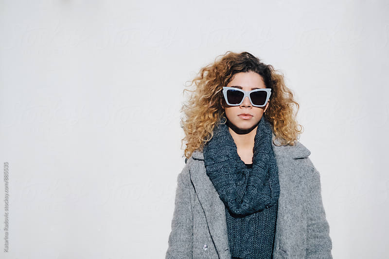 Beautiful Young Woman With Sunglasses and Curly Hair by Katarina Radovic for Stocksy United
