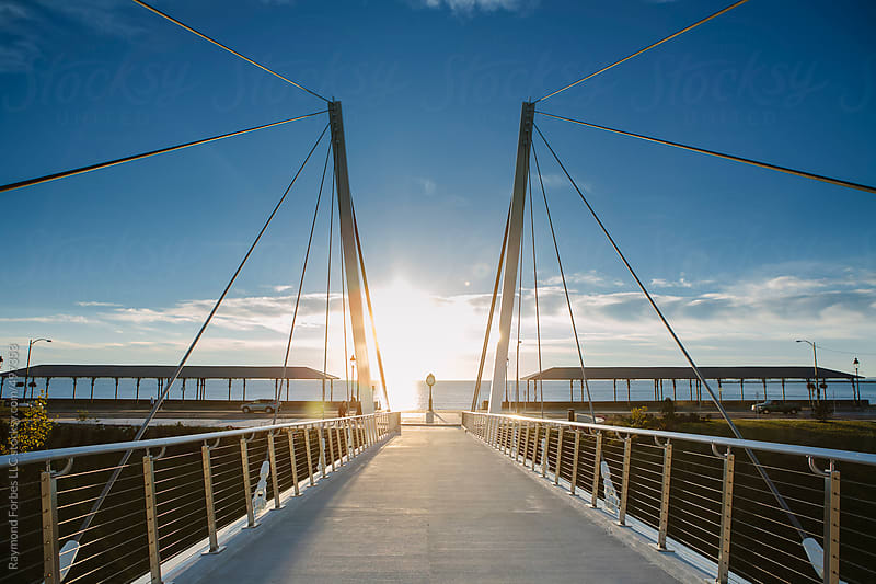 Pedestrian Suspension Bridge by Raymond Forbes LLC for Stocksy United