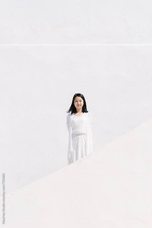 beautiful chinese girl  in Santorini by MaaHoo Studio for Stocksy United