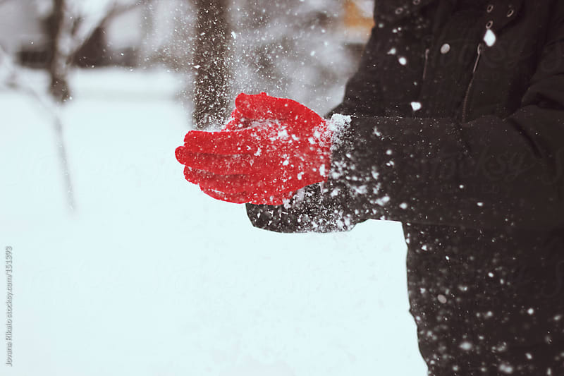Man throws snow into the air by Jovana Rikalo for Stocksy United