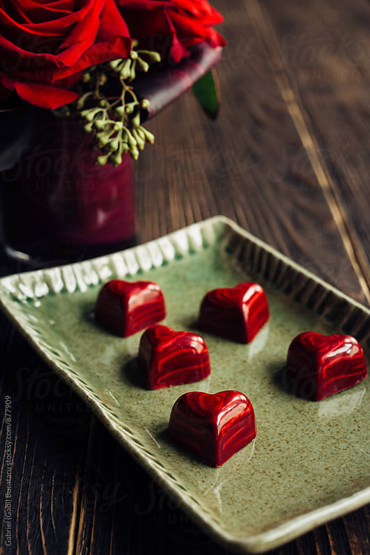 Hear shaped red chocolates on a tray by Gabriel (Gabi) Bucataru for Stocksy United