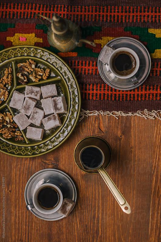 Oriental black coffee, turkish delight and nuts by Aleksandra Jankovic for Stocksy United