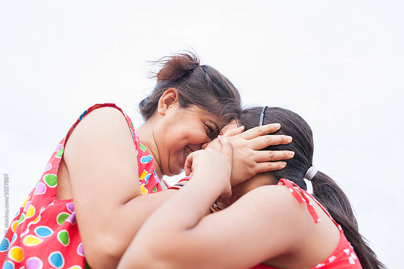Mother and daughter making fun by PARTHA PAL for Stocksy United