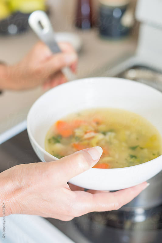 Serving Chicken Soup into a Bowl by suzanne clements for Stocksy United