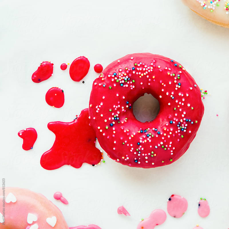 Glazed donut on white background by Pixel Stories for Stocksy United