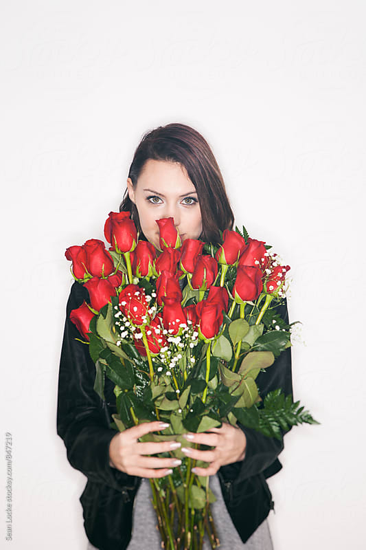 Valentine: Mysterious Woman Holds Two Dozen Roses by Sean Locke for Stocksy United