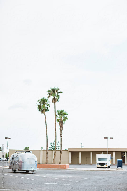 airstream and palm trees in car park by Image Supply Co for Stocksy United