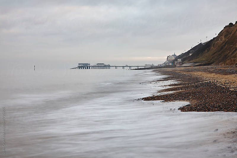 Cromer Pier and slipway, from East Runton beach. Norfolk, UK. by Liam Grant for Stocksy United