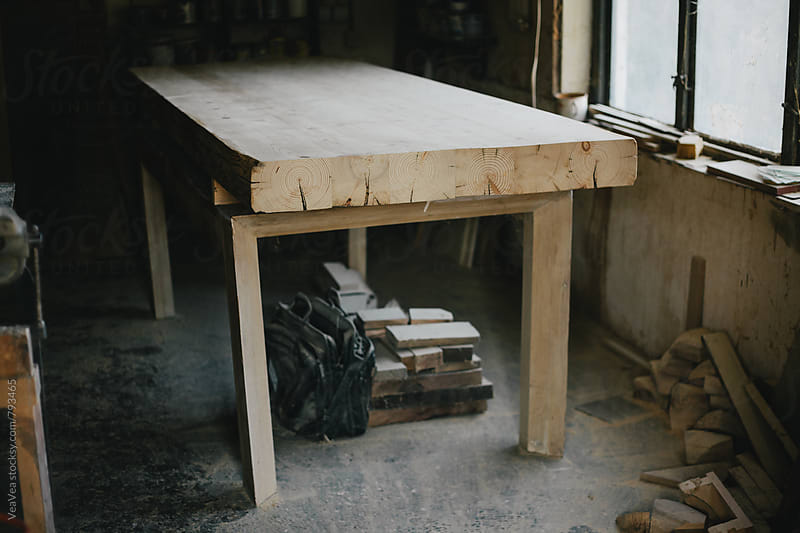 Wooden table in Carpenter's workshop by VeaVea for Stocksy United