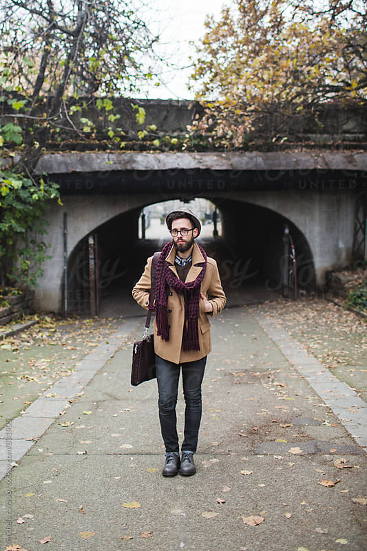 Portrait of young man standing in the street by michela ravasio for Stocksy United
