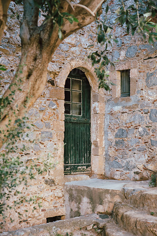 Old door in monemvasia island, Greece. by Alberto Bogo for Stocksy United