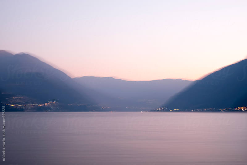 Colors of the lake after sunset, blurred image by michela ravasio for Stocksy United