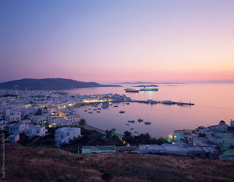 Overview of Mykonos Town and Harbour at dusk. by Hugh Sitton for Stocksy United