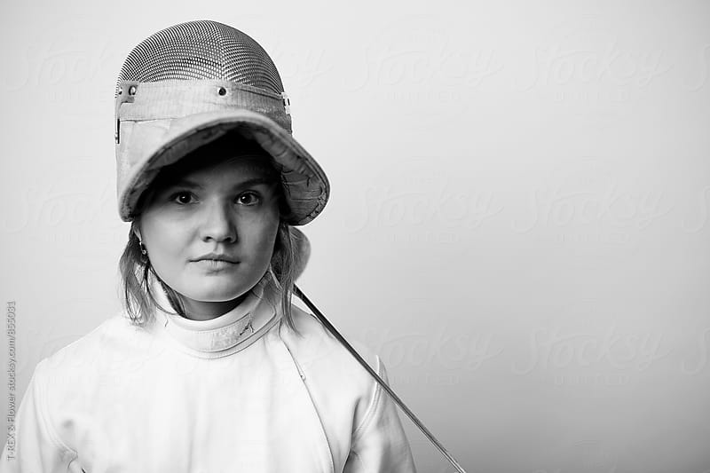 Professional female fencer looking at camera by Danil Nevsky for Stocksy United