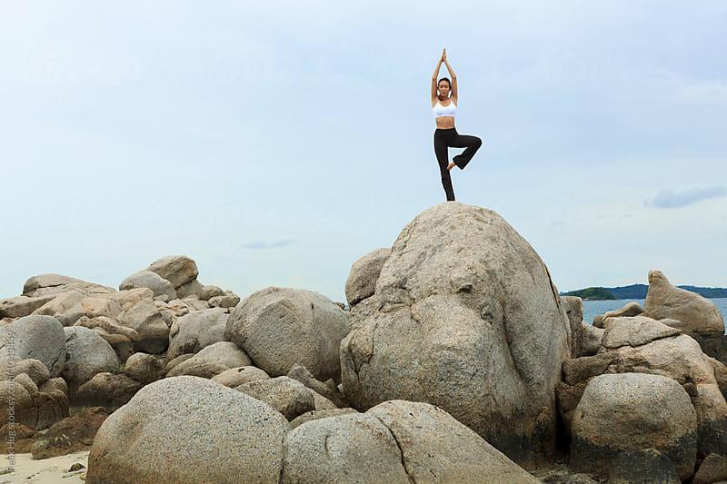 Asian girl doing Yoga by Felix Hug for Stocksy United