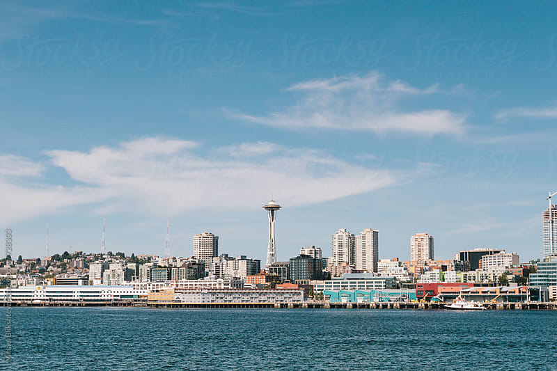 View of Seattle downtown waterfront with Space Needle on a sunny summer day from the water by Mihael Blikshteyn for Stocksy United
