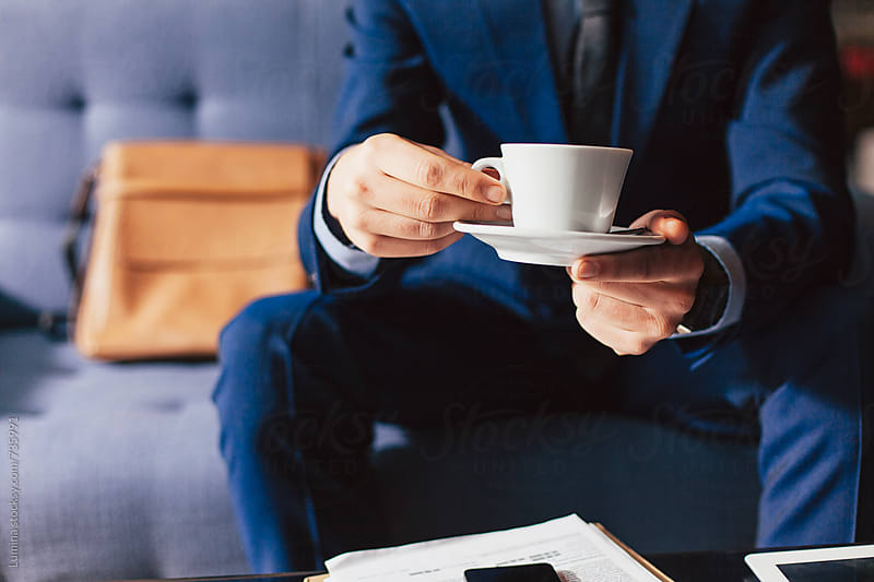 Man in a Suit Drinking Coffee by Lumina for Stocksy United