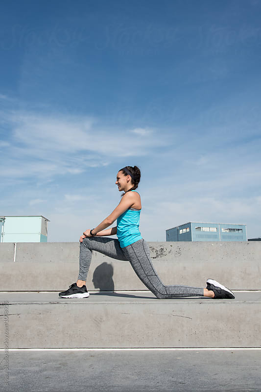 Fit woman working out on the city by Bisual Studio for Stocksy United