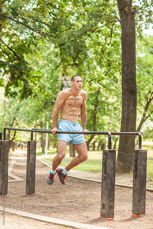 Man Working Out in the Park by Mosuno for Stocksy United