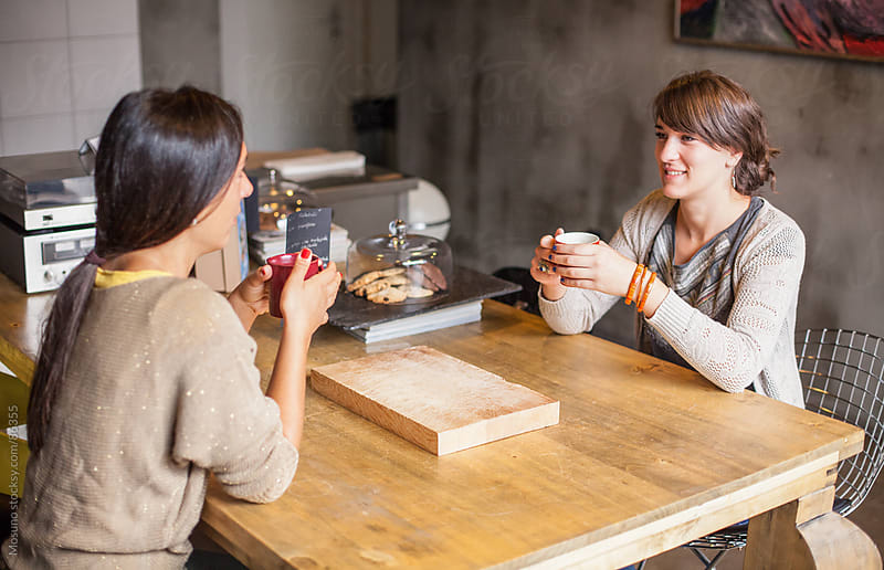 Friends Drinking Coffee with Cookies by Mosuno for Stocksy United