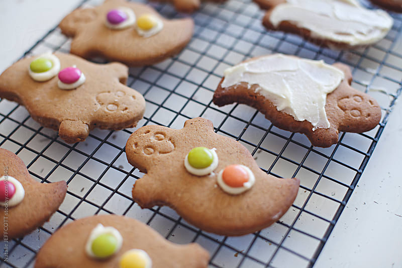 icing gingerbread ghost cookies for Halloween by Natalie JEFFCOTT for Stocksy United