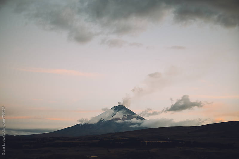 Smoking Volcano at Sunset by Oscar Lopez for Stocksy United