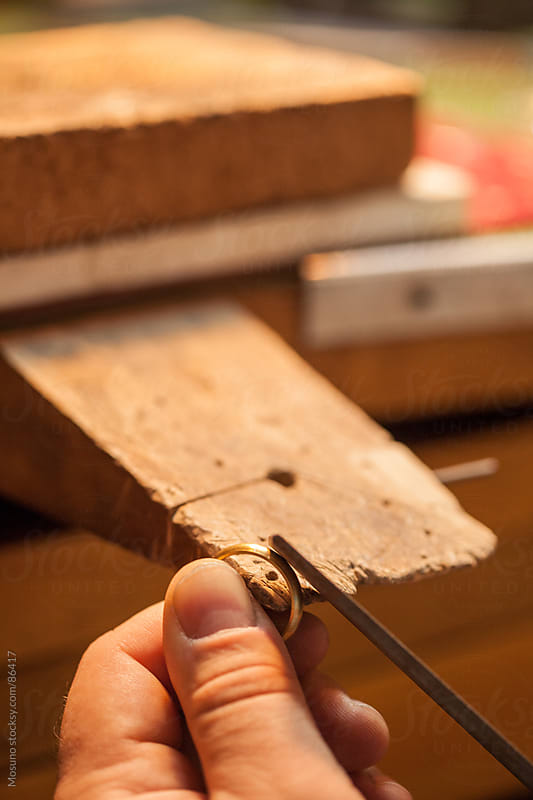 Goldsmith making a golden ring.  by Mosuno for Stocksy United