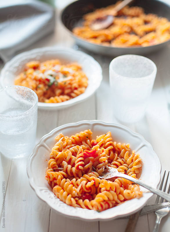 Pasta with tomato sauce by Davide Illini for Stocksy United